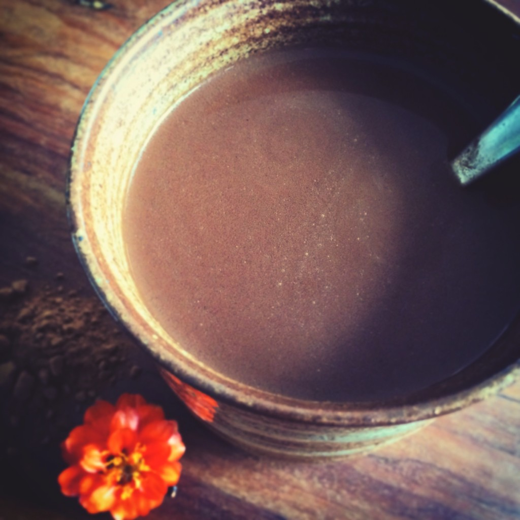 Wholesome Vegan Rainy Day Hot Chocolate in a earthy hand made cup!